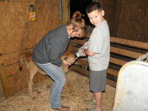 Jonathan & I feeding the new calves.