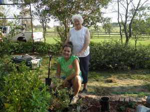 Cheyenne & Grandmother working in the flower beds.