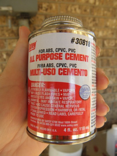 plumber's cement that will be used to glue the PVC pieces together on the pig waterer