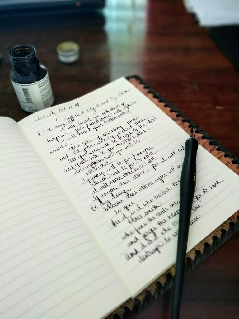 Leather journal with quill pen and ink because a writer loves writing.  Old fashioned romance for the writer of romance books and the herb gardener.