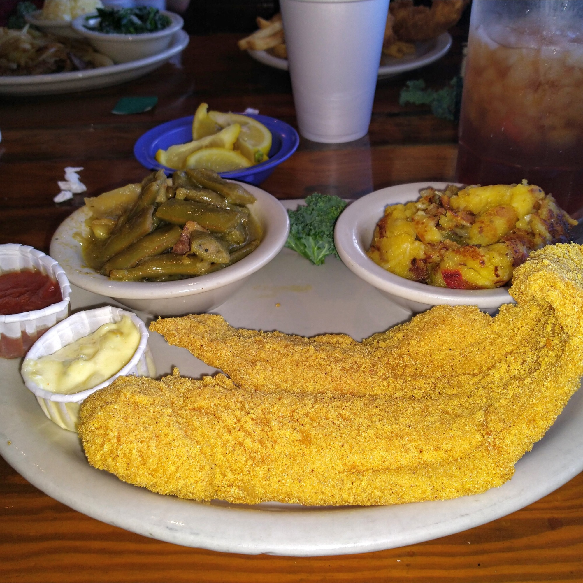 fried-fish-with-crab-dressing-and-green-beans-at-Millers-seawall-grill-in-galveston-texas