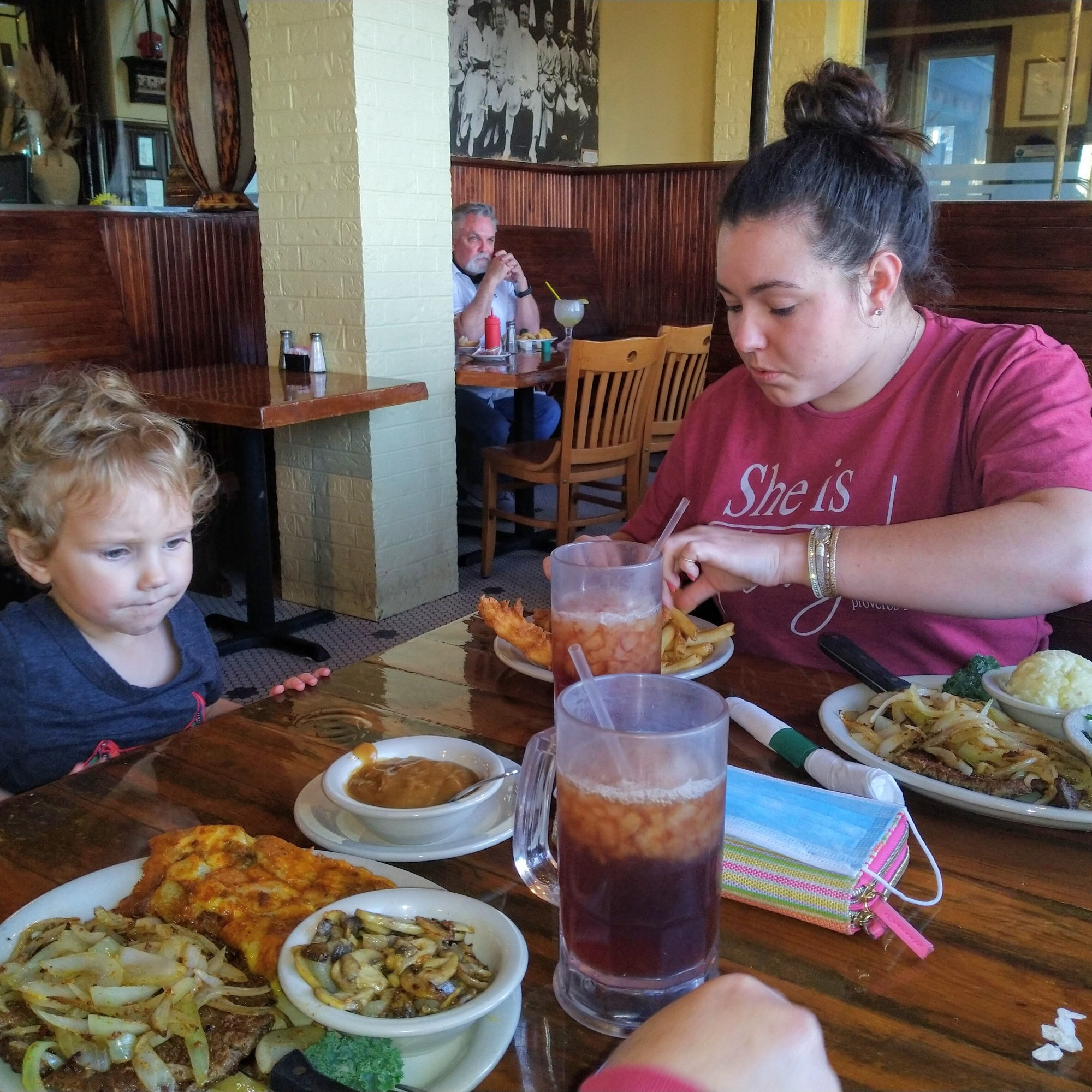 table-full-of-food-with-family-at-miller's-seawall-grill-in-Galveston