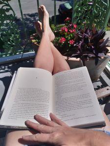 Reading on the balcony, Galveston Texas, Pretty legs and flowers on Galveston Island