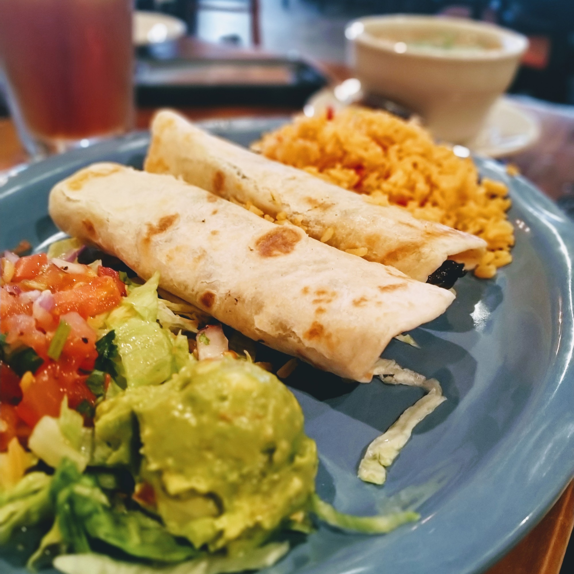 Fresh- pico -de- gallo-fresh-guacomole-spanish-rice-and-tacos-al-carbon-served-with-charo-beans-in-galveston-texas-at-tacos-al-carbon
