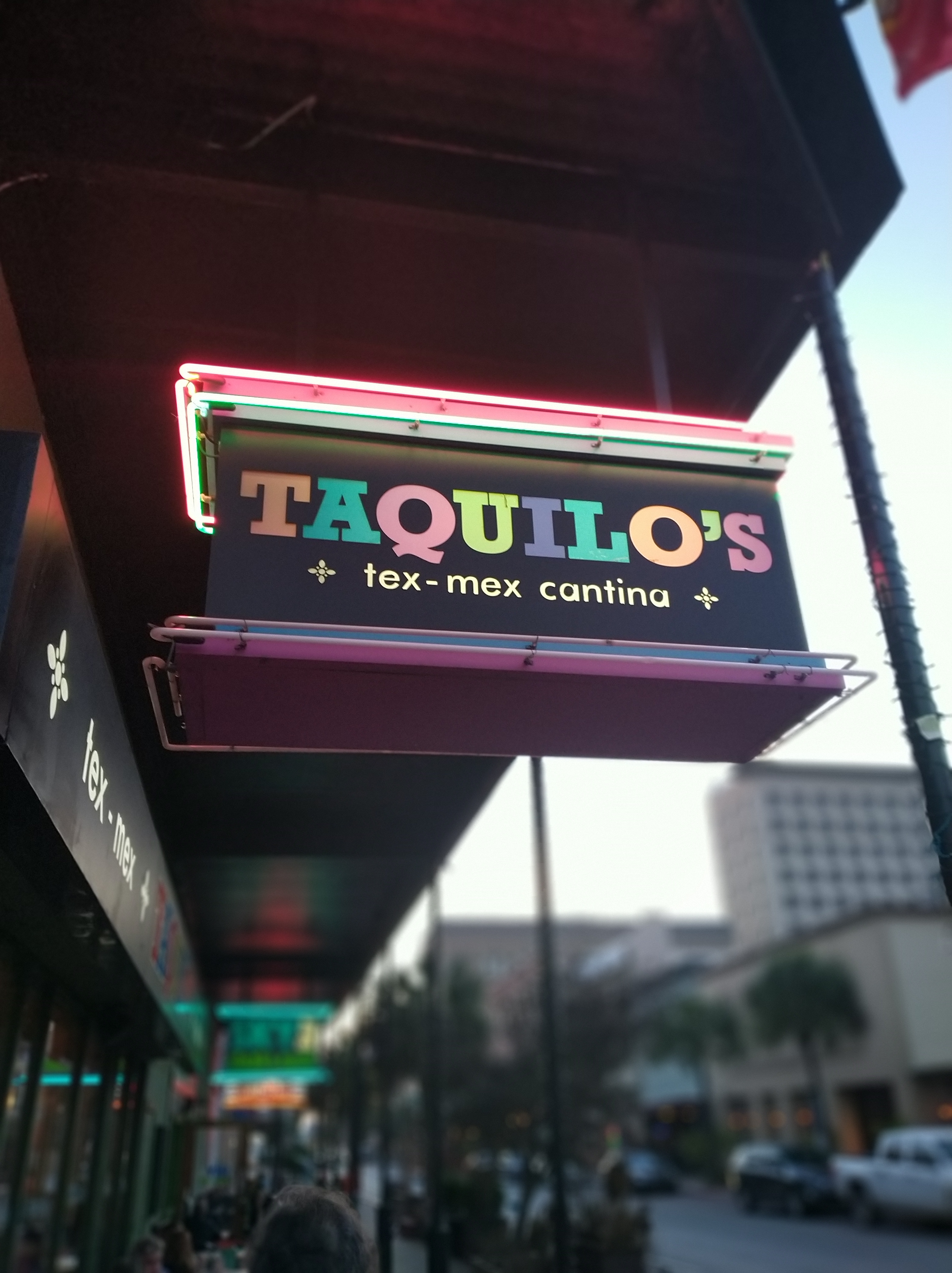 Neon-sign-for-taquillos-texmex-cantina-in-galveston-texas-at-sunset
